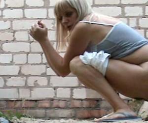 blonde-caught-pissing