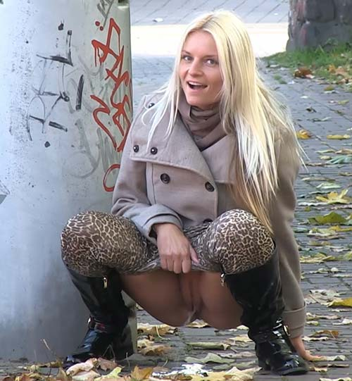 blonde-pissing-on-street